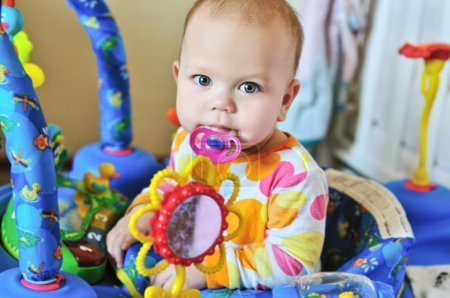 Funny baby with dummy