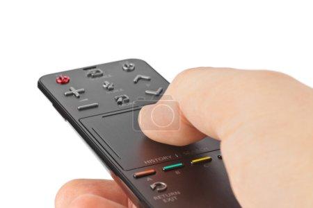 Photo pour La main avec la télécommande du téléviseur isolé sur fond blanc - image libre de droit