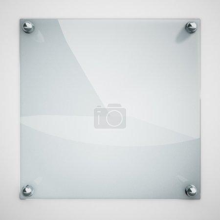 Photo pour Plaque de verre de protection fixée au mur blanc avec des rivets métalliques . - image libre de droit