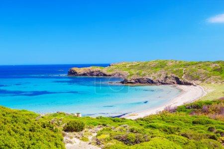 Platja del Tortuga beach in sunny day at Menorca