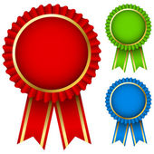 Blank award ribbon rosettes in three colors isolated on white