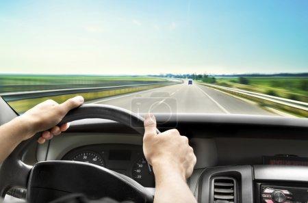 Male hands on wheel