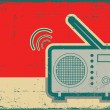 Retro radio.Vector grunge poster on old texture...
