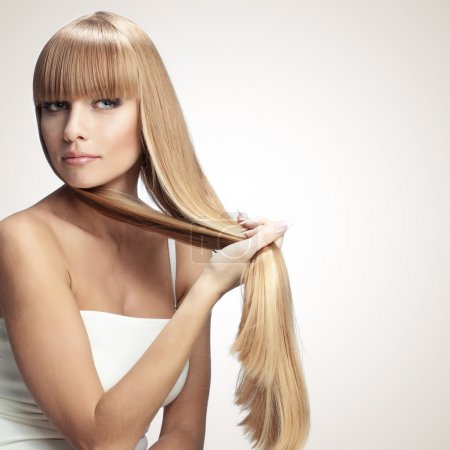 Photo for Portrait of beautiful girl with perfect long shiny blond hair studio shot - Royalty Free Image