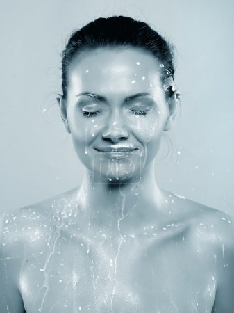 Woman in milk sprays