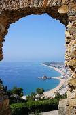 Beach Blanes view through arch. Costa Brava, Catalonia, Spain