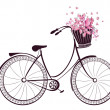 Bicycle with a basket full of flowers and butterfl...