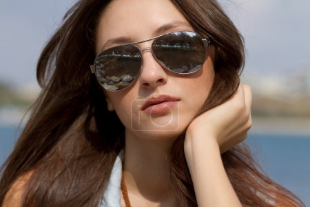 Cool young girl in sunglasses