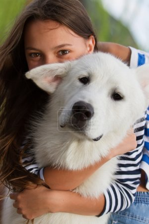 Girl with white alaskan malamute dog