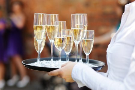 Photo for Waiter serving champagne at festive event - Royalty Free Image