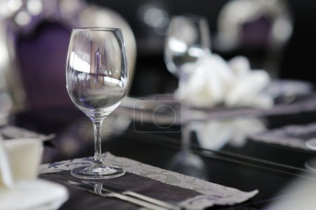 Photo for Wine glass on a table decorated for an event celebration - Royalty Free Image