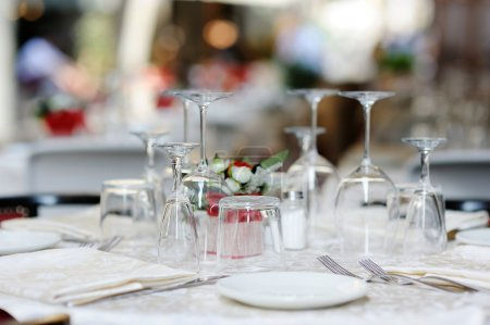 Photo for Table set for an event party or dinner - Royalty Free Image