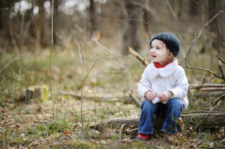 Adorable girl on early spring or autumn