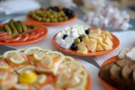 Dishes with snacks on the table