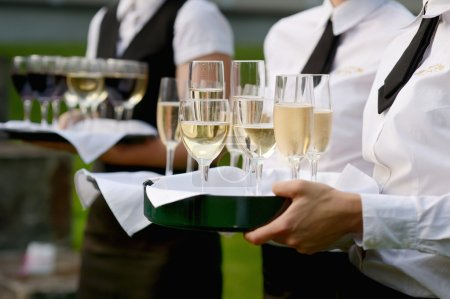 Photo for Waitress with dish of champagne and wine glasses - Royalty Free Image
