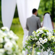White flowers decorations during outdoor wedding c...