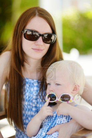 Mother and daughter relaxing in outdoor restaurant