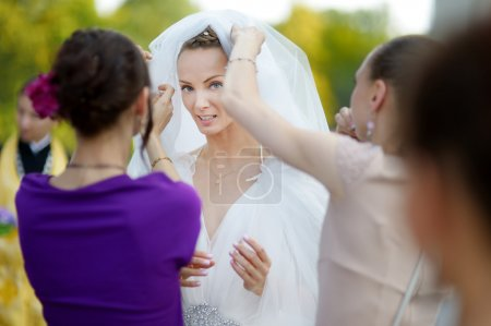 The beautiful bride outdoors before wedding