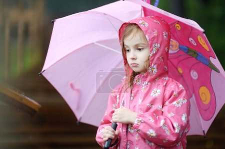 Adorable little girl at rainy day