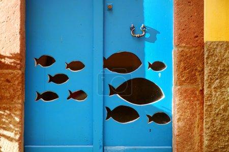 Fish on blue door