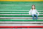 Girl sitting on   stadium