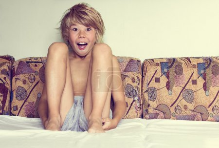 boy sitting in the bed