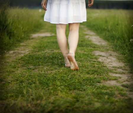 Photo for Bare feet of beautiful woman walking on the grass - Royalty Free Image