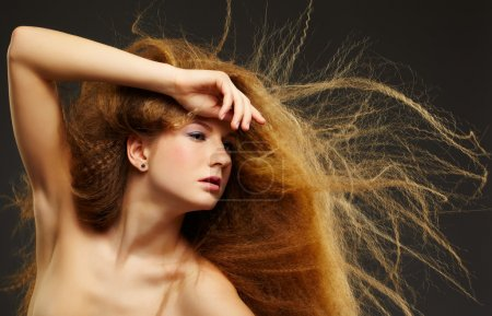 long-haired curly red-haired woman