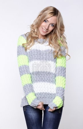 woman in grey and green sweater