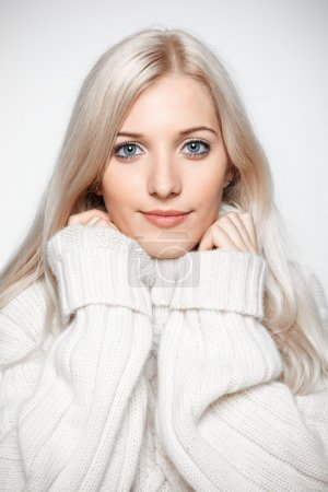 Blonde woman in cashmere sweater