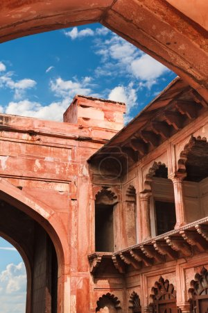 Red sandstone arches of the inner courtyard of Agra Red Fort