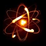 Symbol of atom over black background...