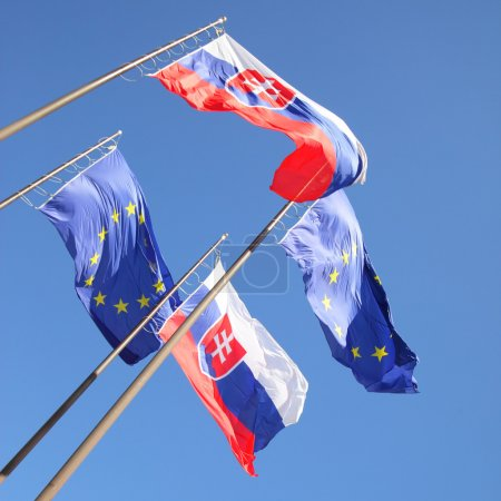 Photo for Flags of European Union and Slovakia in the wind - Royalty Free Image