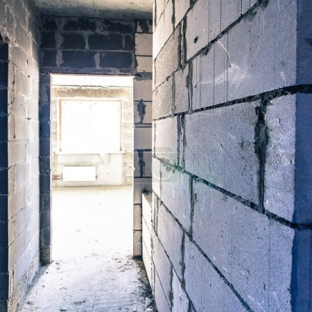 Photo for Corridor in reconstructioned house, grey brick walls - Royalty Free Image