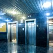 Modern lift with opened and closed doors incide ap...