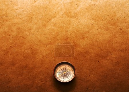 Compass on paper background