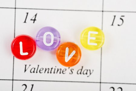 Calendar page with LOVE on February 14 of Saint Valentines day.