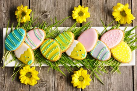 Photo for Easter homemade gingerbread cookie over wooden table - Royalty Free Image
