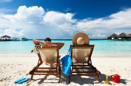Photo for Couple on a tropical beach at Maldives - Royalty Free Image