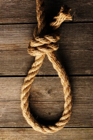 Photo for Rope noose with knot over old wooden background - Royalty Free Image