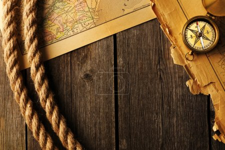 Photo for Antique brass compass and rope over old map - Royalty Free Image