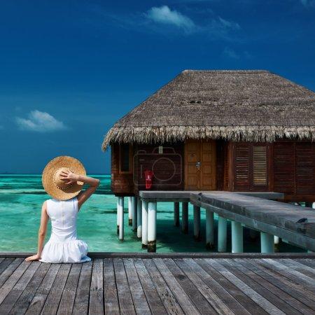 Woman on a beach jetty