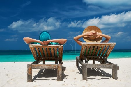 Photo for Couple in green on a tropical beach at Maldives - Royalty Free Image