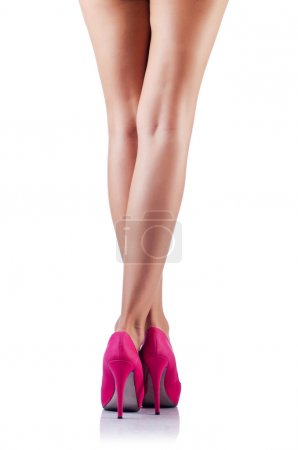 Long woman legs isolated on white