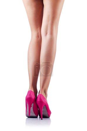 Photo pour Longues jambes de femme isolées sur blanc - image libre de droit