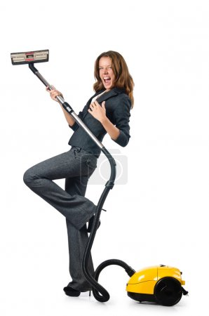 Businesswoman cleaning with vacuum cleaner