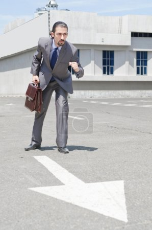 Photo for Businessman ready to start running - Royalty Free Image