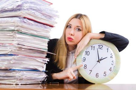 Photo pour Femme occupée avec horloge sur blanc - image libre de droit