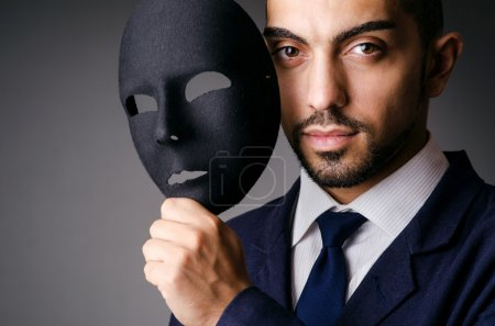 Man with black mask in studio...