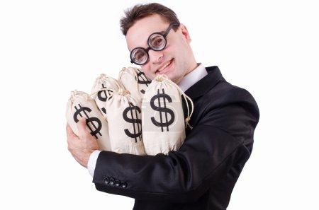 Photo pour Homme d'affaires avec des sacs d'argent sur blanc - image libre de droit
